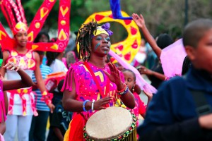 Sophia Jamison drums with Deminufa in the MOJA Arts Festival's opening event, a Caribbean Street Parade down King Street on Thursday evening September 26, 2013. Wade Spees/Staff